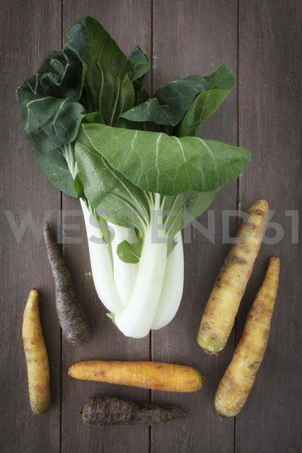 Chinese cabbage and different sorts of carrots on wooden table - EVGF000541