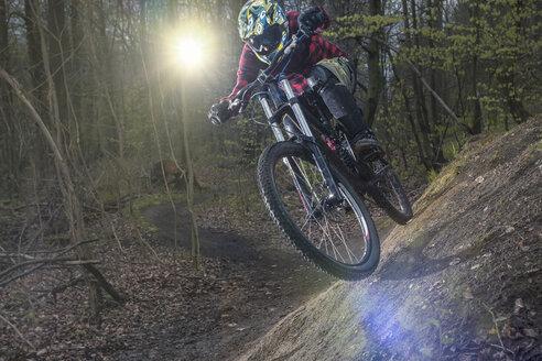 Germany, Lower Saxony, Deister, Bike Freeride in forest - MUMF000054