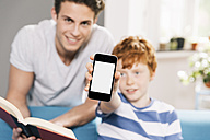 Father and son with book and smartphone - MFF001083
