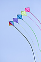 Germany, Hamburg, colourful kites, blue sky - KRPF000435