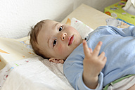 Portrait of baby boy on diaper changing table - LAF000793