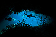 Mexico, Tulum, Two cave divers at the entrance to cenote car wash - YRF000046