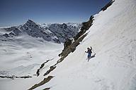 Austria, East Tyrol, Defereggental, Man telemark skiing - FF001410