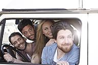 Happy friends in minivan - FMKF001231