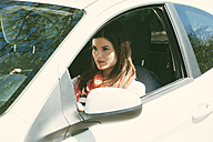 Spain, Barcelona, Young woman in car - EBSF000219
