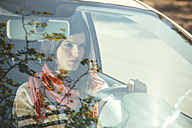 Spain, Barcelona, Young woman in car - EBSF000223