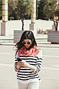 Spain, Barcelona, Young woman with cell phone - EBSF000239