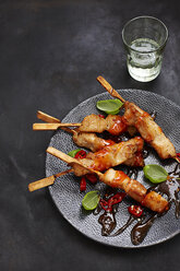 Chicken skewers with sweet-and-sour sauce and chili on plate - KSWF001276