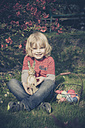 Boy with Easter bunny in garden - MJF000980