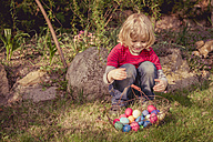 Boy with Easter basket in garden - MJF001014