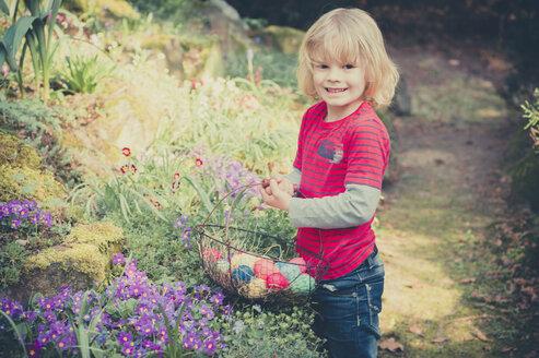 Boy in garden carrying Easter basket - MJF000985