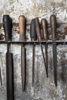 Germany, Bavaria, Josefsthal, fitting with six old metal files at historic blacksmith's shop - TCF003943