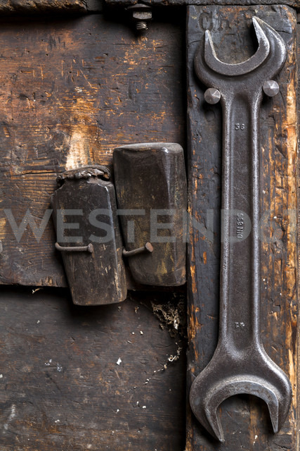 Germany, Bavaria, Josefsthal,two bolts and screw wrench at historic blacksmith's shop - TCF003949