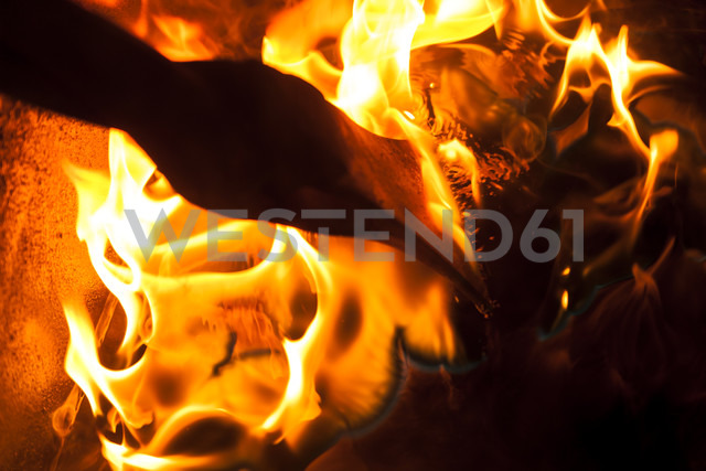 Germany, Bavaria, Josefsthal, axe at flames in historic blacksmith's shop - TCF003961