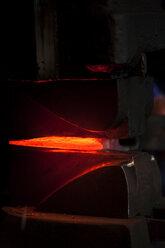 Germany, Bavaria, Josefsthal, glowing axe at historic blacksmith's shop - TCF003939