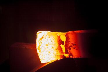 Germany, Bavaria, Josefsthal, glowing axe at historic blacksmith's shop - TCF003940