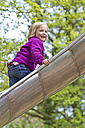 Portrait of smiling little girl on chute - JFEF000346