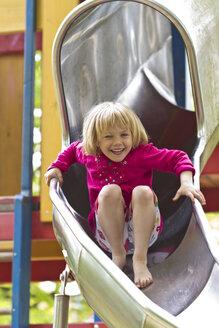 Little girl sliding on chute - JFEF000351