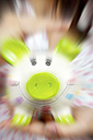 Woman shaking piggy bank, close-up - HOHF000758