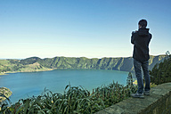 Portugal, Azores, Sao Miguel, Man taking picture of Lagoa das Sete Cidades - ONF000542