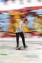 Skate boarder making Ollie at skateboard ground - LAF000746