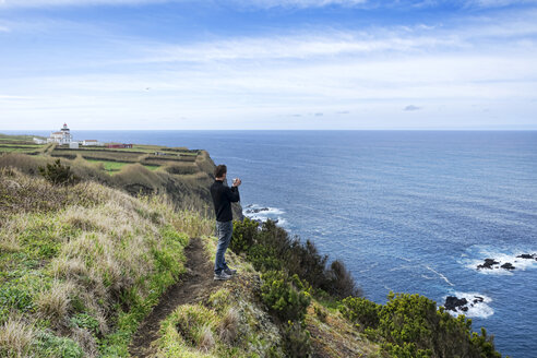 Portugal, Azores,Sao Miguel, Tourist capturing view - ONF000459