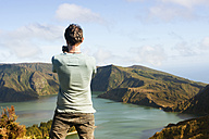 Portugal, Azores,Sao Miguel, Tourist capturing view - ONF000481