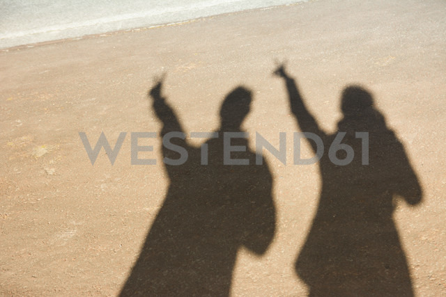Portugal, Azores,Sao Miguel, Shades on man and woman in sand - ONF000468