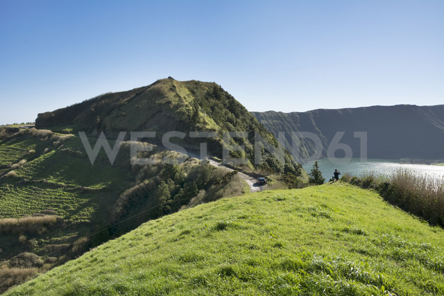 Portugal, Azores,Sao Miguel, Tourist capturing view - ONF000470