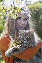 Portrait of female teenager with cat on her arms - SARF000569