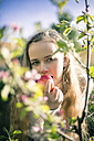 Portrait of female teenager with apple - SARF000561