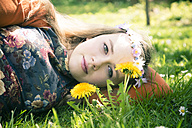 Portrait of female teenager lying on meadow - SARF000564
