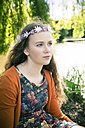 Portrait of female teenager wearing flowers - SARF000566