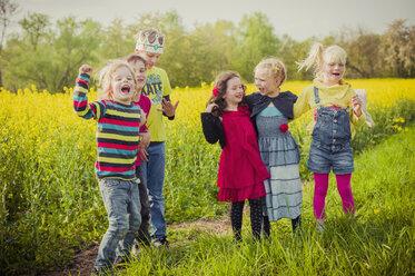 Six children standing in front of rape field - MJF001111