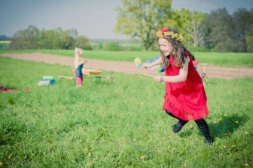 Little girls running on a meadow - MJF001124