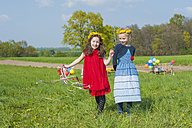 Two little girls with playing on a meadow - MJF001128