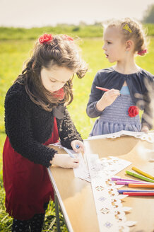 Two little girls painting paper crowns  for birthday party - MJF001161