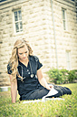 Portrait of young female nurse learning - ABAF001333