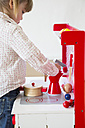 Little girl playing with children's kitchen - LVF001182