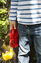 Little girl with little red watering can, partial view - LVF001186