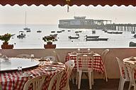 China, Hong Kong, Lamma Island, seating in a restaurant at the waterfront of Yung Shue Wan - SH001242