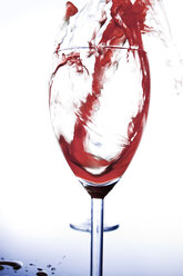 Red wine pouring into wine glass - CNF000033