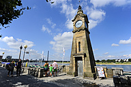 Germany, North Rhine-Westphalia, Duesseldorf, view to clock tower at Rhine river promenade - MIZ000460