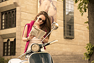 Young woman with road map and Vespa - FCF000180
