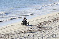 Australia, Western Australia, Lancelin,  motorcyclist driving on the beach, elevated view - MIZ000474