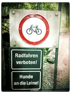 Prohibited Cycling and dogs on a leash signs at gate, Landhut, Bavaria, Germany - SARF000580