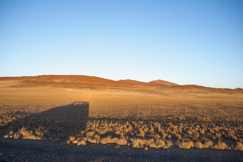 Africa, Namibia, Sossusvlei, Shadow of a car and sand dunes - HLF000468