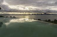 Thailand, Ko Yao Noi, Andaman Sea with infinity pool in foreground - THA000334