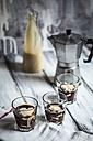 Glasses of Affogato alla zabaglione, bottle of zabaglione and espresso can on wooden table - SBDF000873