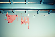 Bikini hanging on clothes line under the roof - KRPF000456